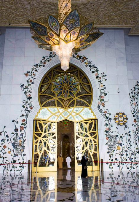 Chandeliers and florals designs at the entrance of the main prayer hall