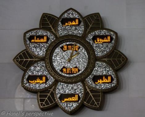 Prayer time clocks with Arabic script